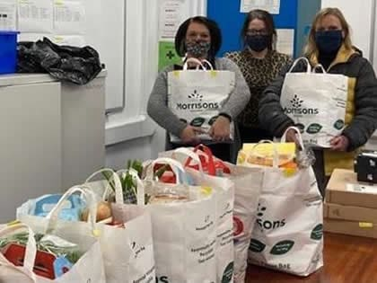 Wykham staff with food parcels